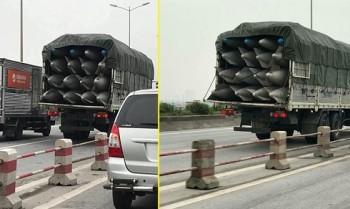 2 xe tai cho vat the la nghi bom chay bon bon tren duong ha noi